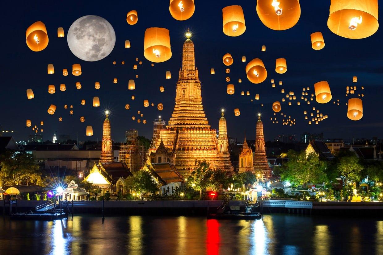 Floating lamp in yee peng festival under loy krathong day at wat arun, Full moon at night in bangkok city, Thailand